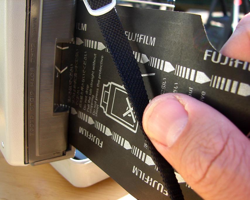 Loading Fuji FP3000B into Land Camera 210, Andrew D. Barron©7/31/11
