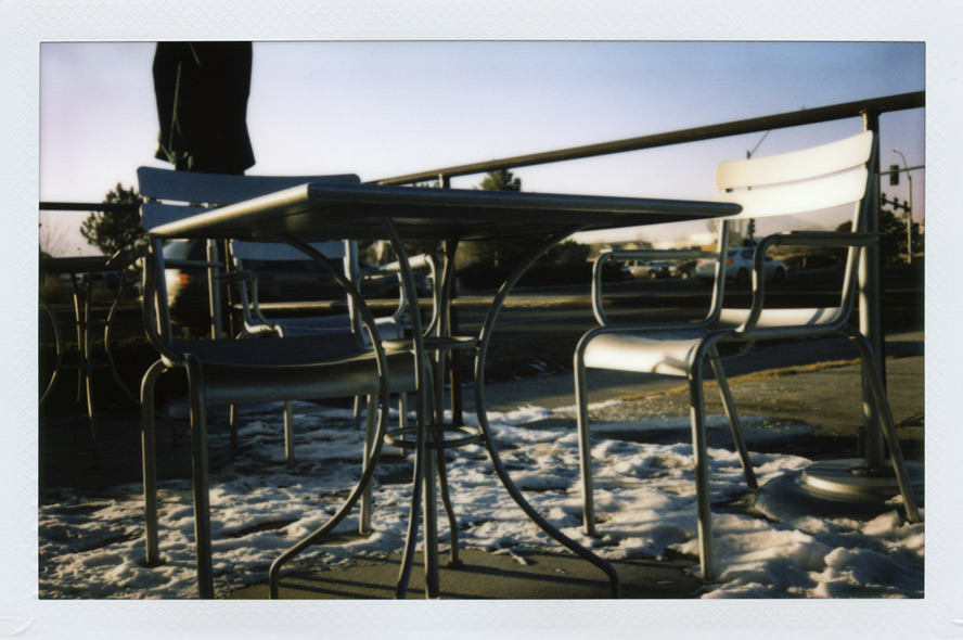 Two empty chairs, south Reno, NV, Andrew D. Barron©1/21/13 [Fujifilm Instax 210, silver edition]