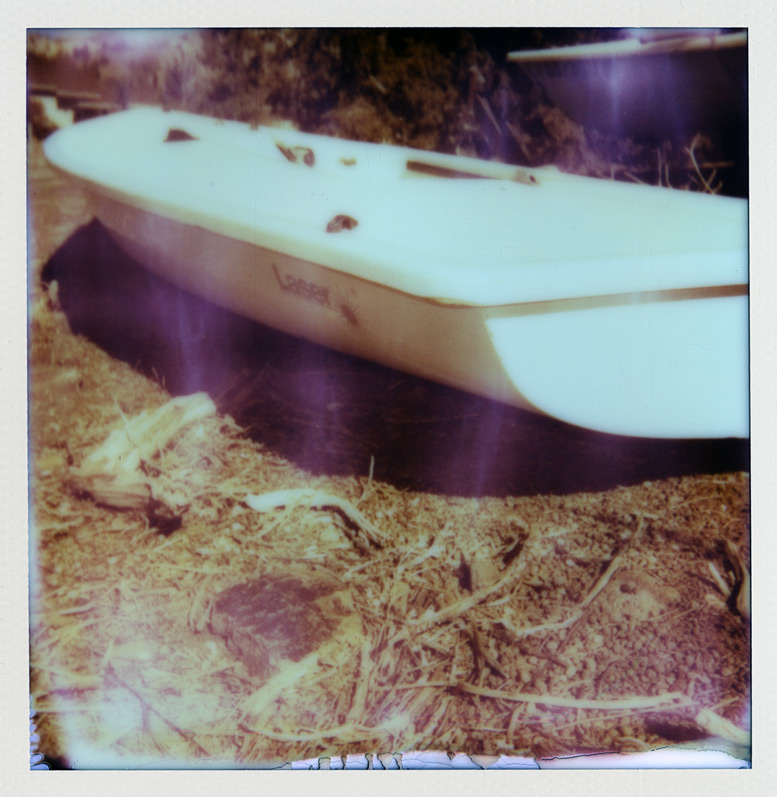 Laser sailboat rests for the season, Reno, NV, Andrew D. Barron©2/13/13 [Polaroid Sun 600: Impossible color protection]